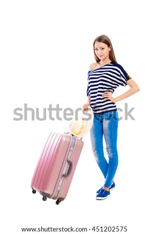 Young attractive woman in blue jeans with a suitcase isolated on white background. Recreation and tourism concept. - stock photo