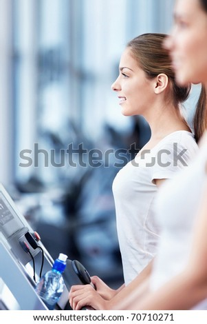 Young attractive woman in the fitness club - stock photo