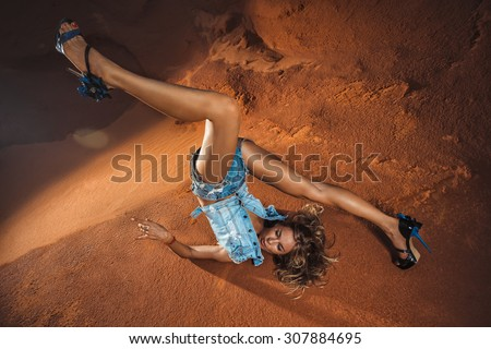 Young attractive woman is falling  head over heels - stock photo