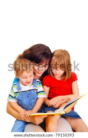Young attractive woman is reading a book with her children - stock photo