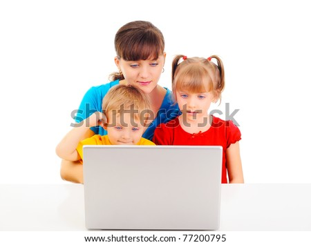 Young attractive woman is teaching her children - stock photo