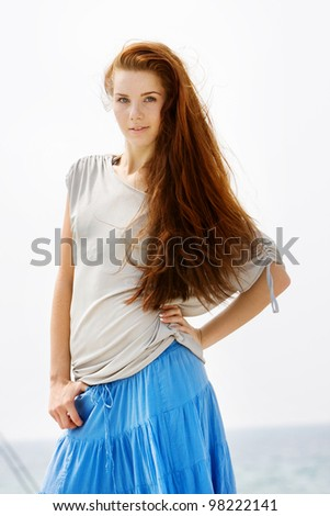young attractive woman isolated over sky - stock photo