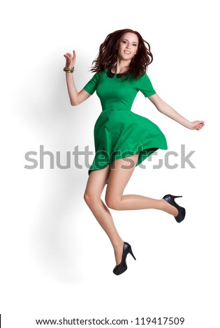 Young attractive woman jumping in the air. Isolated on white - stock photo