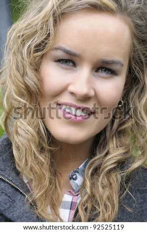 Young attractive woman looking at camera. - stock photo