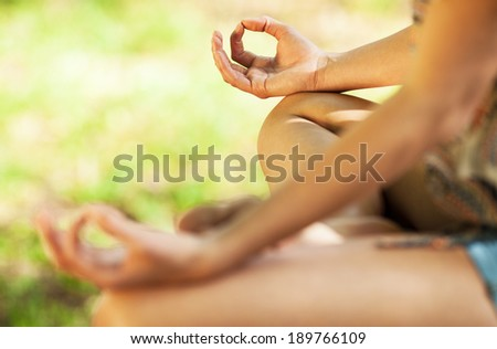 Young attractive woman meditate in nature. - stock photo