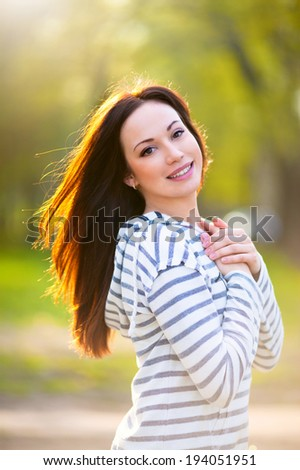 Young attractive woman on a summer day - stock photo