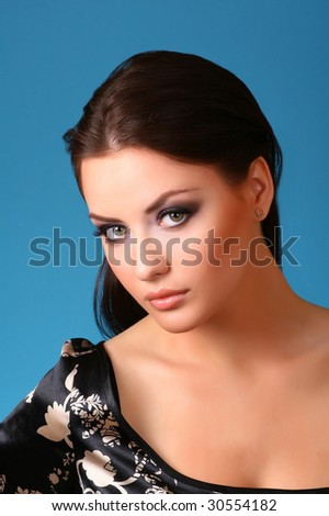 young attractive woman on blue - stock photo