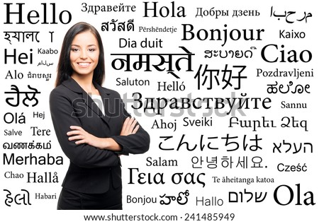 Young attractive woman over the background with a different world languages (language school concept) - stock photo