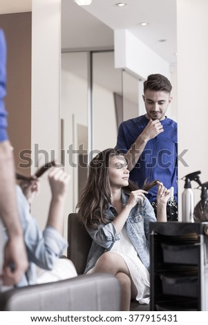 Young attractive woman playing with her hair - stock photo