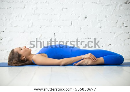young fitness woman blue leotard resting stock photo
