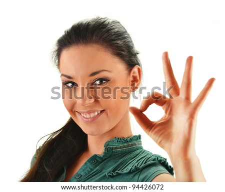 Young attractive woman showing ok isolated on white - stock photo