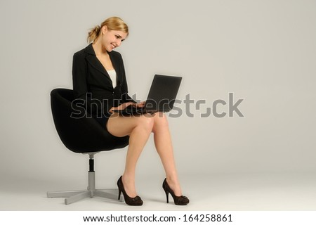 Young attractive woman sitting in a chair - stock photo