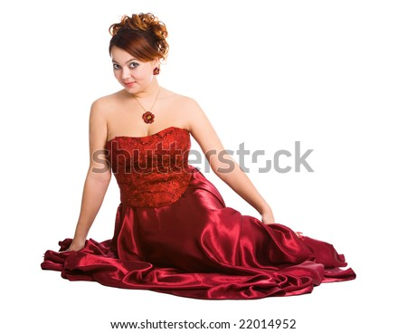 young attractive woman sitting in long red dress. - stock photo