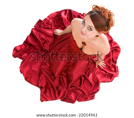 young attractive woman sitting in long red dress. view from above/ - stock photo