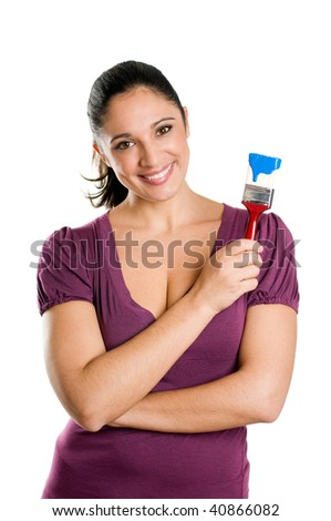 Young attractive woman smiling and holding a blue paintbrush ready for paint - stock photo