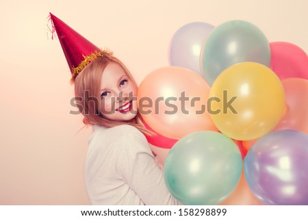 Young attractive woman smiling in amazement with a balloons - stock photo