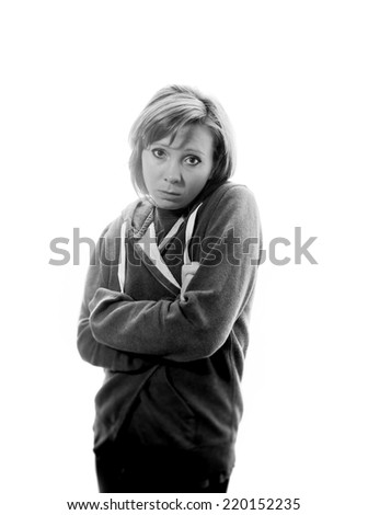 young attractive woman suffering depression and stress standing alone in pain and grief against window feeling sad and desperate at home with studio backlight black and white - stock photo