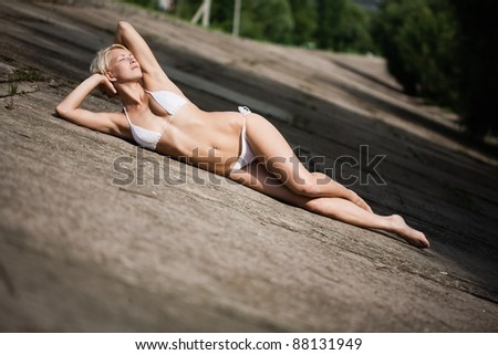 Young attractive woman sunbathing - stock photo