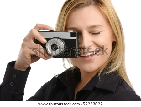 young attractive woman taking a shot with retro photo camera, isolated over white - stock photo