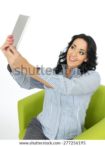 Young Attractive Woman Using a Wireless Tablet Taking a Selfie