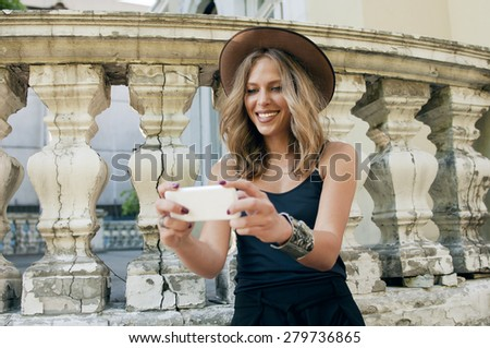 Young attractive woman using smart phone with smile on her face  - stock photo