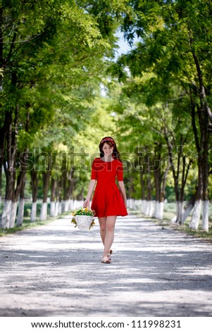 Young attractive woman walking and enjoying in nature