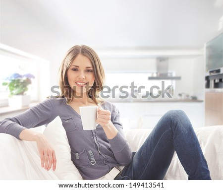 Young attractive woman with a cup of coffee - stock photo