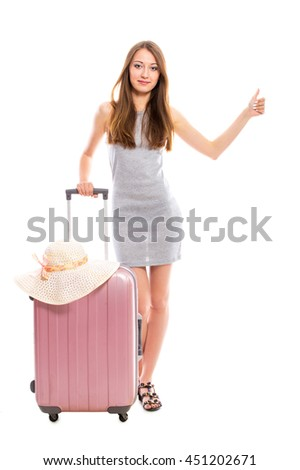 Young attractive woman with a suitcase isolated on white background. - stock photo