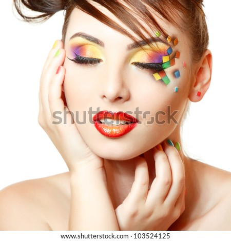 young attractive woman with beautiful art cube abstract make-up isolated on white background