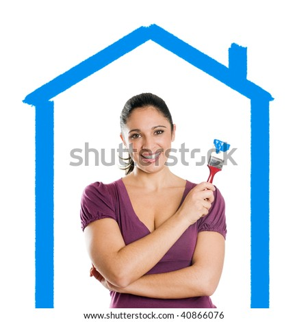 Young attractive woman with blue paintbrush dreaming her new house - stock photo