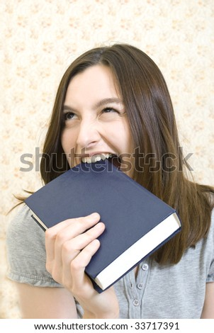 Young attractive woman with book - stock photo