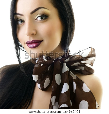 Young attractive woman with bow of neck-piece and nice makeup looking at camera, studio shot of pretty girl over white - stock photo