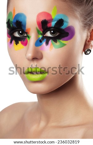 young attractive woman with bright colorful creative make up. glamour style close up portrait - stock photo
