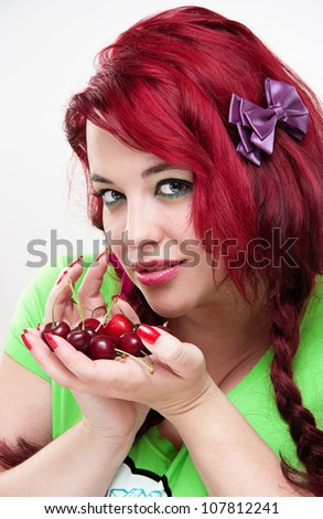 Young attractive woman with cherries - stock photo