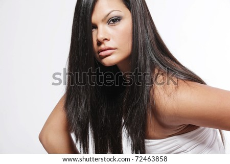 Young attractive woman with long black hair on white background. - stock photo