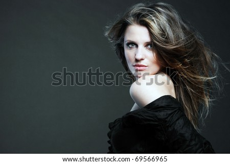 Young attractive woman with long hair. - stock photo