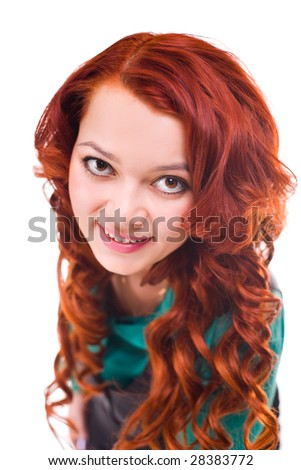 young attractive woman with long rust-coloured hair. image with small depth of field - stock photo
