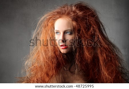Young attractive woman with red hair - stock photo