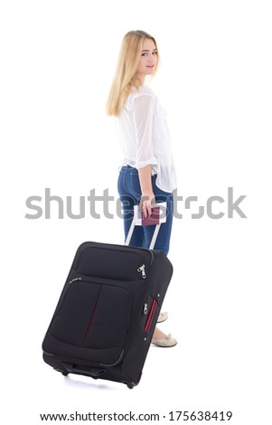 young attractive woman with suitcase, passport and ticket isolated on white background - stock photo