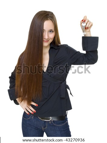 young attractive woman with the keys in her hand - stock photo