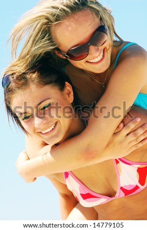 Young attractive women enjoying together the summer beach