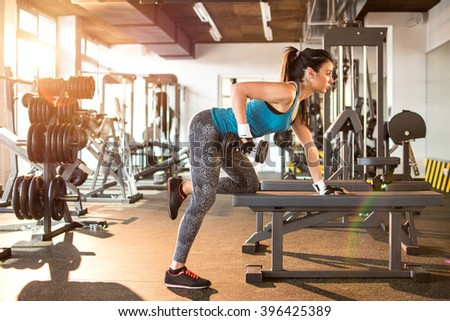 Young attractive women in gym. - stock photo