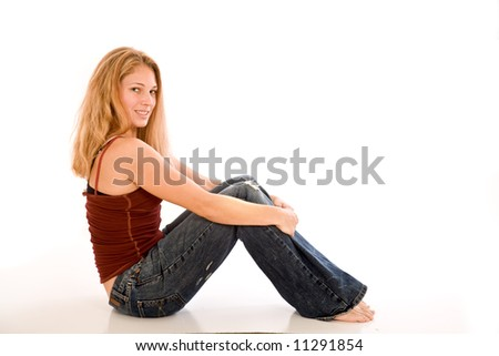 Young attractive women sitting on a floor