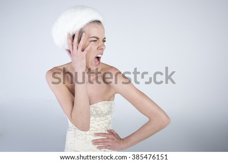 young attractive women wearing white dress in studio