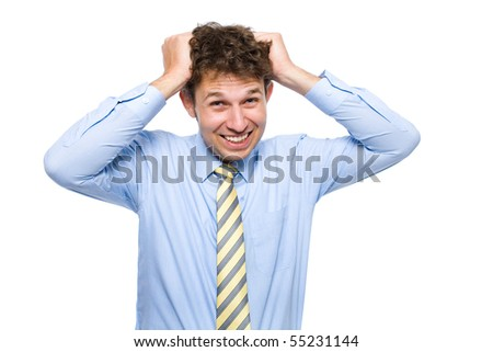 young attractive young male, wearing blue shirt and yellow necktie, tears his hairs out, studio shoot isolated on white background - stock photo
