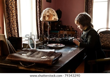 Young author in a grandpa's room