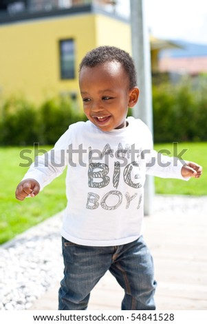 Young baby boy in the garden - stock photo