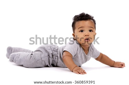 young baby boy wearing casual outfit on white background - stock photo