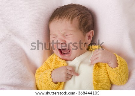 young baby crying, studio picture - stock photo