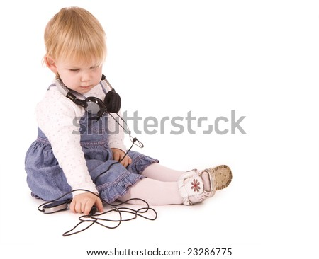 Young baby girl wearing phone headset